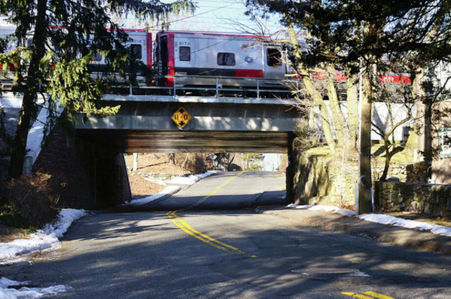 Hour photo / Erik TrautmannThe Common Council's Public Works Committee has recommending advancing a $2.3 million contract torebuild Rowayton Avenue beneath Metro-North Railroad's New Haven Line bridge. / (C)2013, The Hour Newspapers, all rights reserved