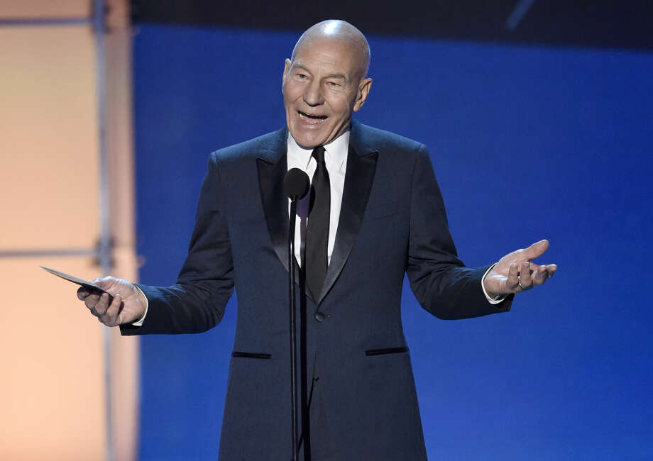 Sir Patrick Stewart presents the award for best drama series at the 21st annual Critics' Choice Awards at the Barker Hangar on Sunday, Jan. 17, 2016, in Santa Monica, Calif. (Photo by Chris Pizzello/Invision/AP)