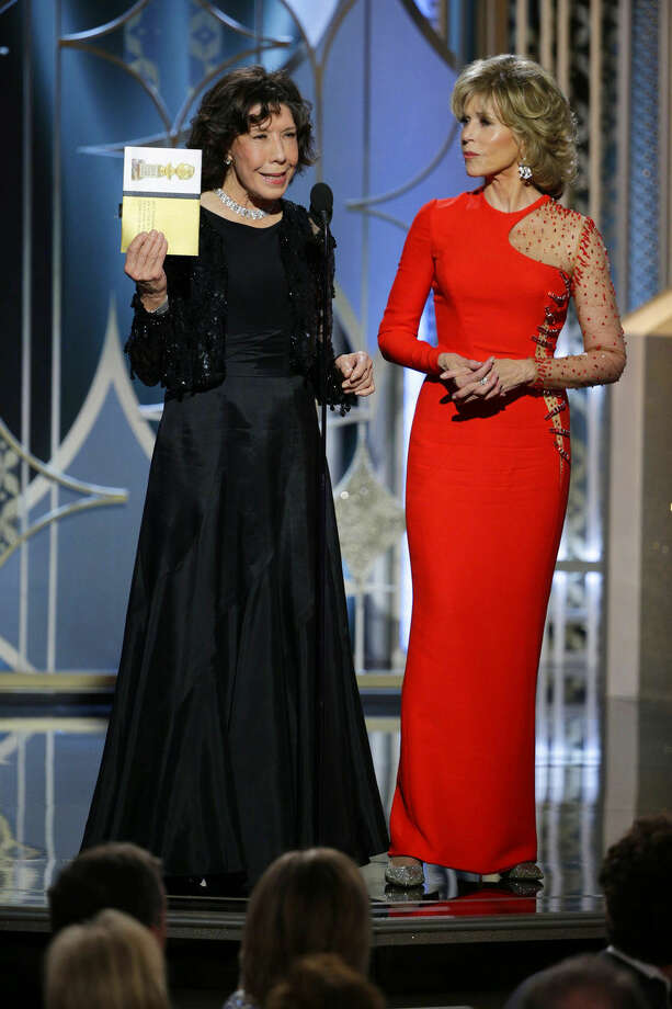 In this image released by NBC, Lily Tomlin, left, and Jane Fonda present an award at the 72nd Annual Golden Globe Awards on Sunday, Jan. 11, 2015, at the Beverly Hilton Hotel in Beverly Hills, Calif. (AP Photo/NBC, Paul Drinkwater)