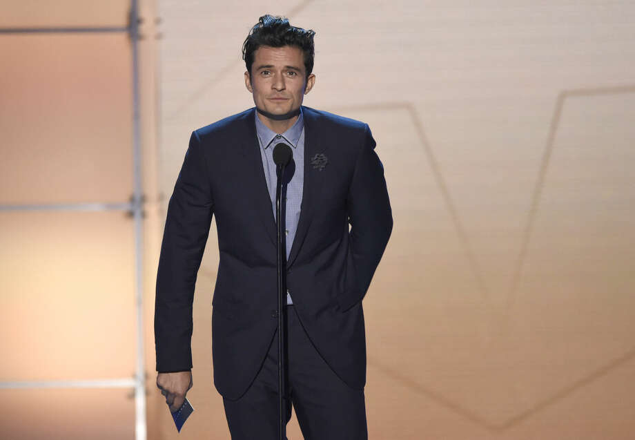 Orlando Bloom presents the award for best actress at the 21st annual Critics' Choice Awards at the Barker Hangar on Sunday, Jan. 17, 2016, in Santa Monica, Calif. (Photo by Chris Pizzello/Invision/AP)