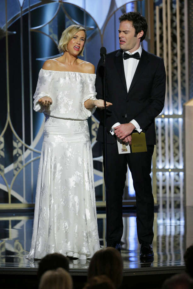 In this image released by NBC, Kristen Wiig, left, and Bill Hader present an award at the 72nd Annual Golden Globe Awards on Sunday, Jan. 11, 2015, at the Beverly Hilton Hotel in Beverly Hills, Calif. (AP Photo/NBC, Paul Drinkwater)