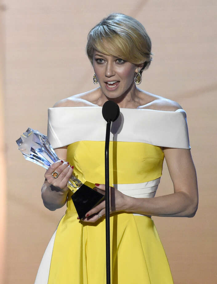 "Carrie Coon accepts the award for best actress in a drama series for ""The Leftovers"" at the 21st annual Critics' Choice Awards at the Barker Hangar on Sunday, Jan. 17, 2016, in Santa Monica, Calif. (Photo by Chris Pizzello/Invision/AP)"