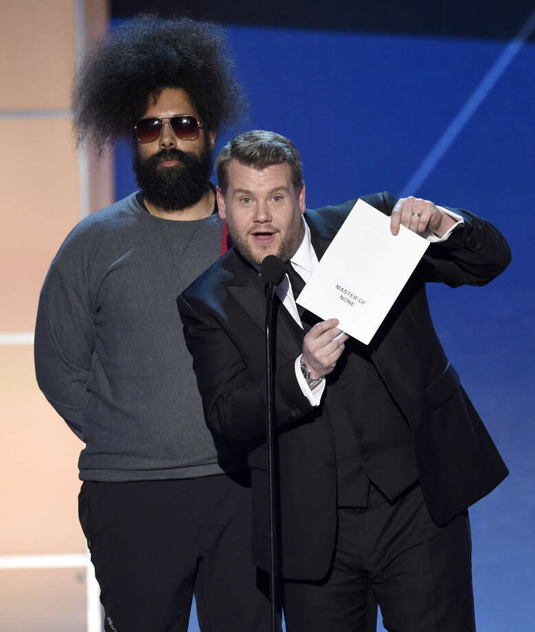 Reggie Watts, left, and James Corden present the award for best comedy series at the 21st annual Critics' Choice Awards at the Barker Hangar on Sunday, Jan. 17, 2016, in Santa Monica, Calif. (Photo by Chris Pizzello/Invision/AP)