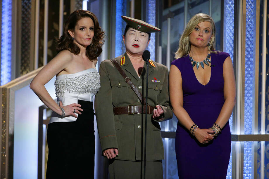 In this image released by NBC, Tiny Fey, from left, Margaret Cho, and Amy Poehler speak at the 72nd Annual Golden Globe Awards on Sunday, Jan. 11, 2015, at the Beverly Hilton Hotel in Beverly Hills, Calif. (AP Photo/NBC, Paul Drinkwater)