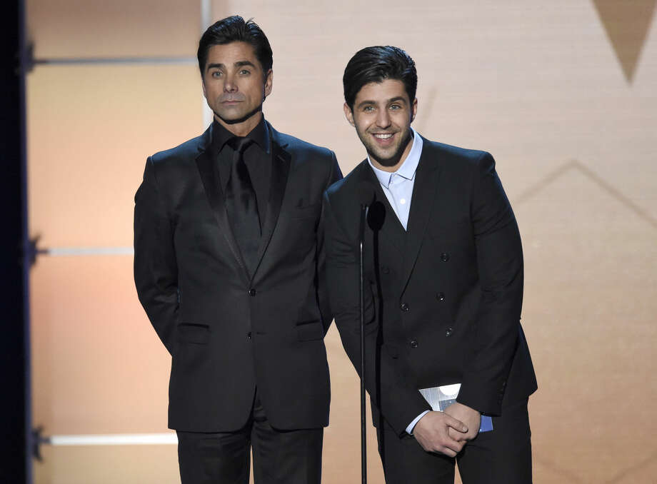 John Stamos, left, and Josh Peck present the award for best actress in a drama series at the 21st annual Critics' Choice Awards at the Barker Hangar on Sunday, Jan. 17, 2016, in Santa Monica, Calif. (Photo by Chris Pizzello/Invision/AP)