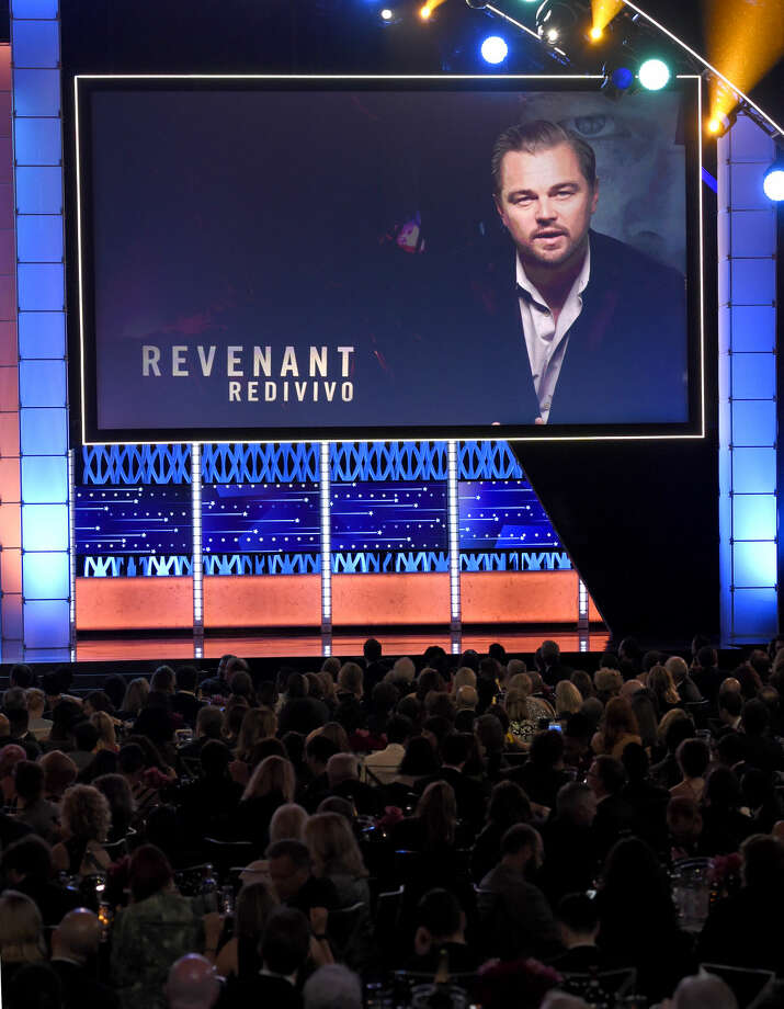 "Leonardo DiCaprio is seen on screen accepting the award for best actor for ""The Revenant"" at the 21st annual Critics' Choice Awards at the Barker Hangar on Sunday, Jan. 17, 2016, in Santa Monica, Calif. (Photo by Chris Pizzello/Invision/AP)"