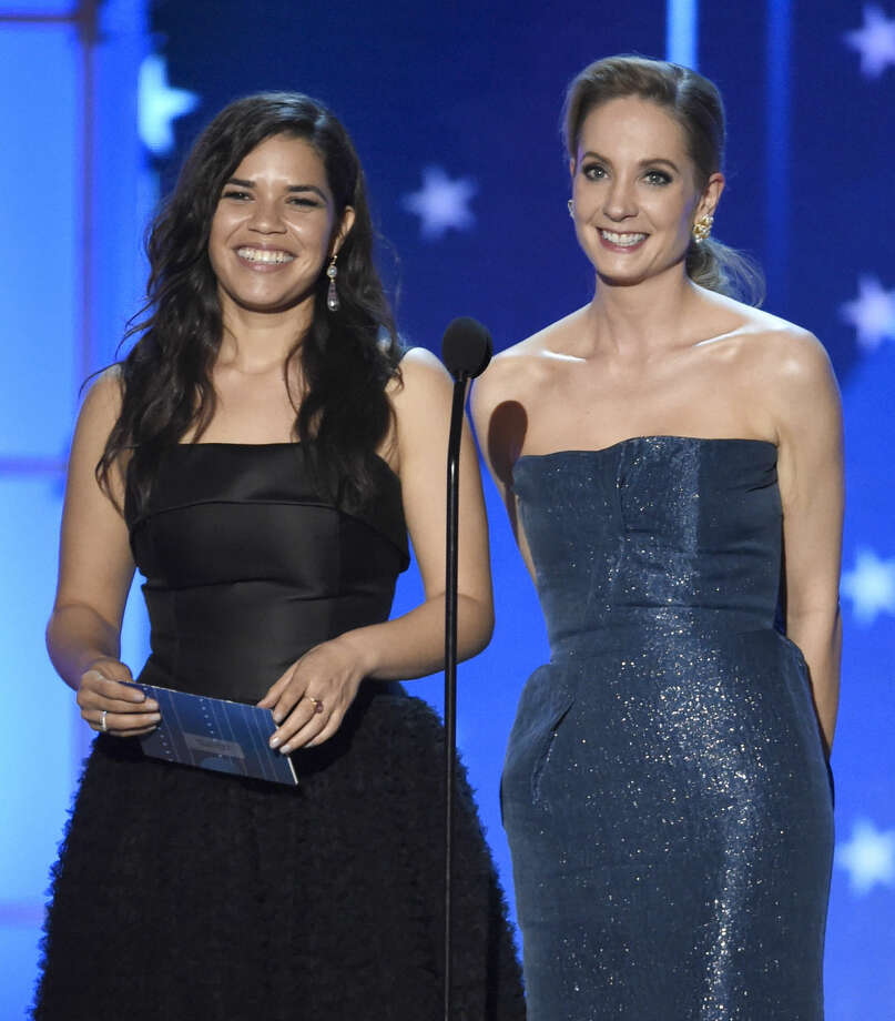 America Ferrera, left, and Joanne Froggatt present the award for best actor in a drama series at the 21st annual Critics' Choice Awards at the Barker Hangar on Sunday, Jan. 17, 2016, in Santa Monica, Calif. (Photo by Chris Pizzello/Invision/AP)