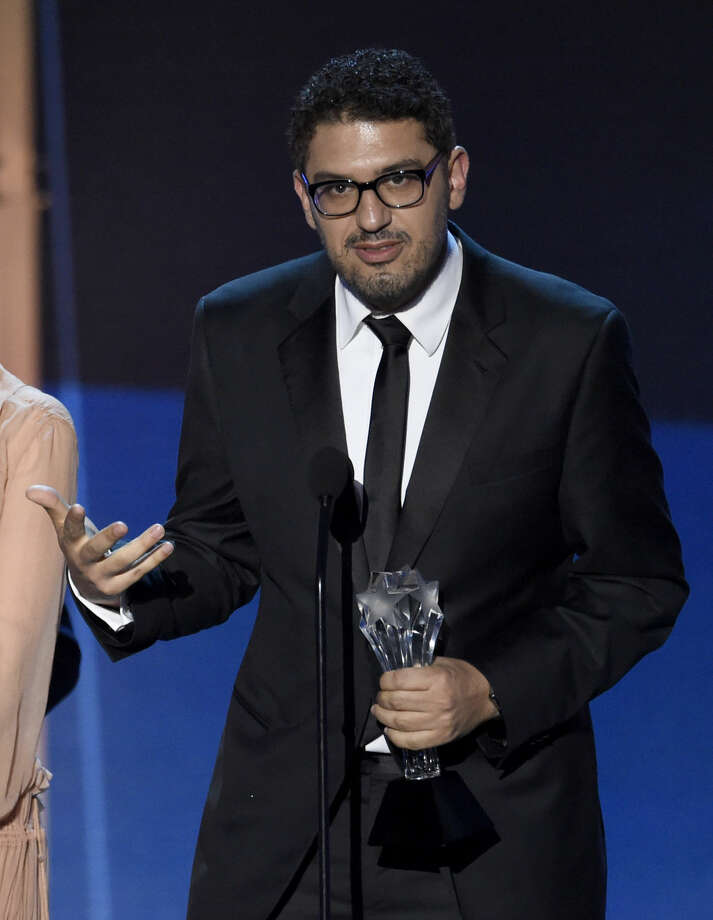 "Sam Esmail accepts the award for best drama series for ""Mr. Robot"" at the 21st annual Critics' Choice Awards at the Barker Hangar on Sunday, Jan. 17, 2016, in Santa Monica, Calif. (Photo by Chris Pizzello/Invision/AP)"