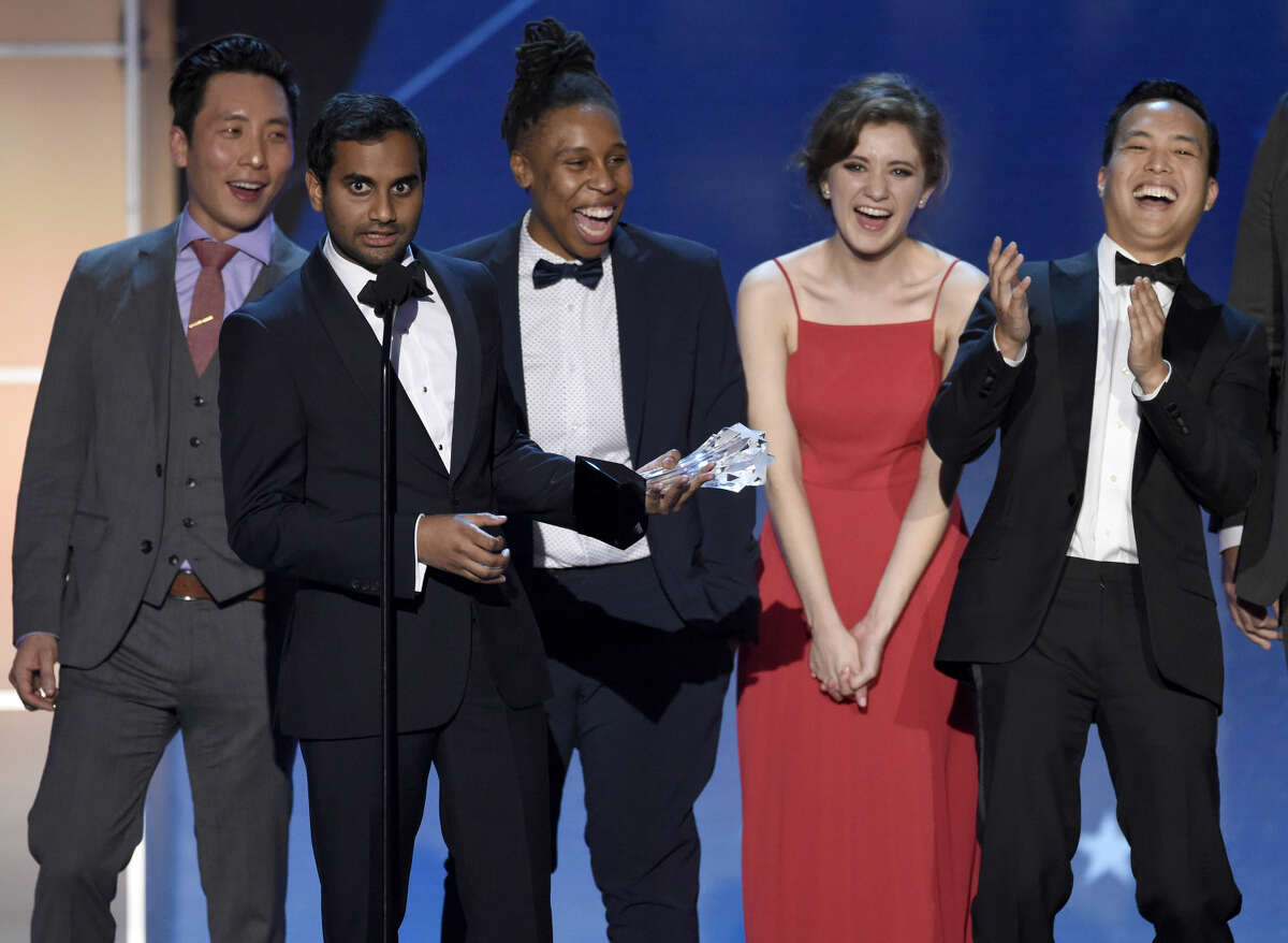 """Kelvin Yu, from left, Aziz Ansari, Lena Waithe, Noel Wells, and Alan Yang accept the award for best comedy series for """"Master of None"""" at the 21st annual Critics' Choice Awards at the Barker Hangar on Sunday, Jan. 17, 2016, in Santa Monica, Calif. (Photo by Chris Pizzello/Invision/AP)"""