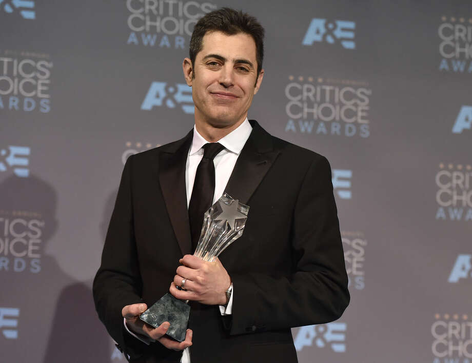 "Josh Singer poses in the press room with the award for original screenplay for ""Spotlight,"" which he accepted on behalf of himself and Tom McCarthy, at the 21st annual Critics' Choice Awards at the Barker Hangar on Sunday, Jan. 17, 2016, in Santa Monica, Calif. (Photo by Jordan Strauss/Invision/AP)"
