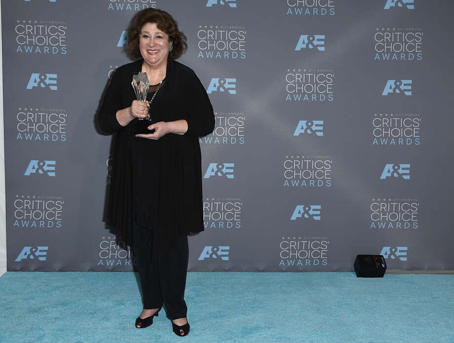 "Margo Martindale poses in the press room with the award for best guest actor/actress in a drama series for ""The Good Wife"" at the 21st annual Critics' Choice Awards at the Barker Hangar on Sunday, Jan. 17, 2016, in Santa Monica, Calif. (Photo by Jordan Strauss/Invision/AP)"