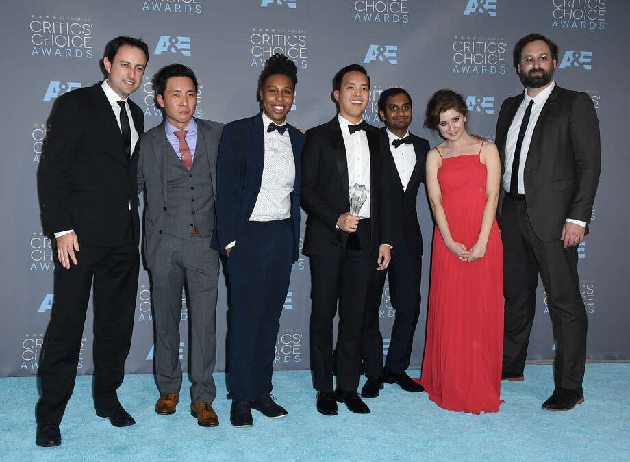 "Igor Srubshchik, from left, Kelvin Yu, Lena Waithe, Alan Yang, Aziz Ansari, Noel Wells, and Eric Wareheim pose in the press room with the award for best comedy series for ""Master of None"" at the 21st annual Critics' Choice Awards at the Barker Hangar on Sunday, Jan. 17, 2016, in Santa Monica, Calif. (Photo by Jordan Strauss/Invision/AP)"