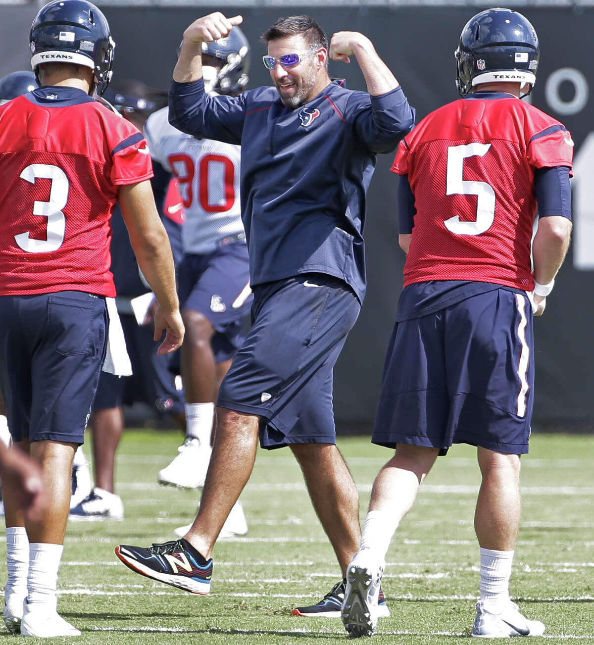Texans assistant coach Mike Vrabel, center, talks with Tom Savage, left, and Brandon Weeden, right, during offseason workouts at NRG Park Friday, June 10, 2016, in Houston.