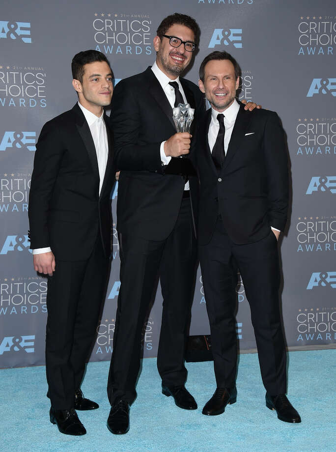 "Rami Malek, from left, Sam Esmail, and Christian Slater pose in the press room with the award for best drama series for ""Mr. Robot"" at the 21st annual Critics' Choice Awards at the Barker Hangar on Sunday, Jan. 17, 2016, in Santa Monica, Calif. (Photo by Jordan Strauss/Invision/AP)"