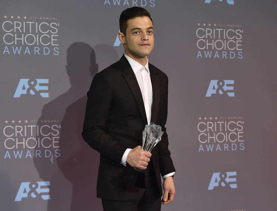 "Rami Malek poses in the press room with the award for best actor in a drama series for ""Mr. Robot"" at the 21st annual Critics' Choice Awards at the Barker Hangar on Sunday, Jan. 17, 2016, in Santa Monica, Calif. (Photo by Jordan Strauss/Invision/AP)"