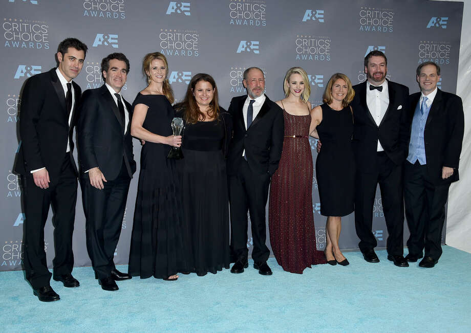 "The cast and crew of ""Spotlight,"" Josh Singer, from left, Brian d'Arcy James, Blye Pagon Faust, Nicole Rocklin, Steve Golin, Rachel McAdams, Sacha Pfeiffer, and far right, Tom Ortenberg, pose in the press room with the award for best picture at the 21st annual Critics' Choice Awards at the Barker Hangar on Sunday, Jan. 17, 2016, in Santa Monica, Calif. (Photo by Jordan Strauss/Invision/AP)"