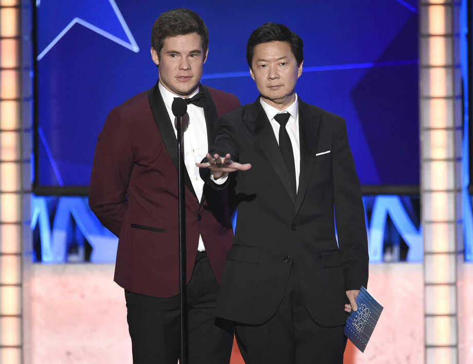 Adam DeVine, left, and Ken Jeong present the award for best actress in a comedy at the 21st annual Critics' Choice Awards at the Barker Hangar on Sunday, Jan. 17, 2016, in Santa Monica, Calif. (Photo by Chris Pizzello/Invision/AP)