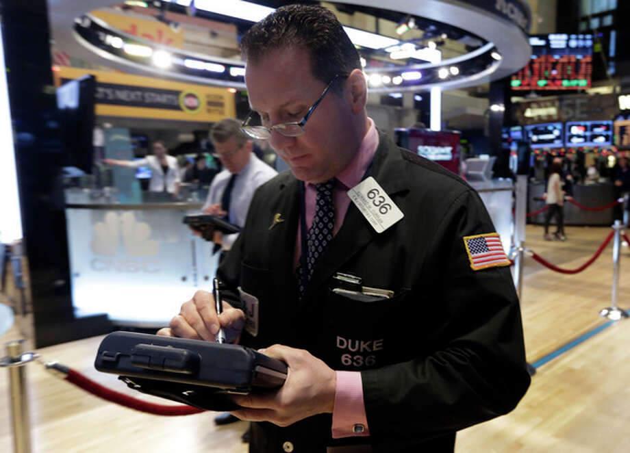 Trader Edward Curran works on the floor of the New York Stock Exchange Wednesday, Jan. 8, 2014.Stocks are mostly lower in early trading as investors hold back ahead of the release of the latest news from the Federal Reserve. (AP Photo/Richard Drew) / AP