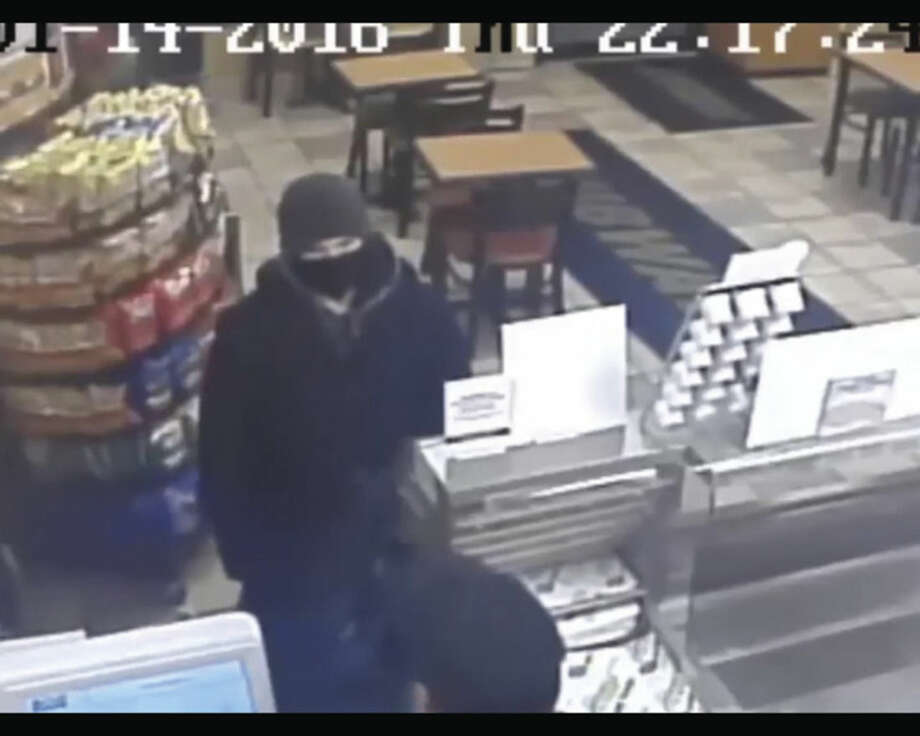 Photo captured from a surveillance camera at the Subway sandwich shop at 417 Shippan Ave. shows the suspect committing an armed robbery.