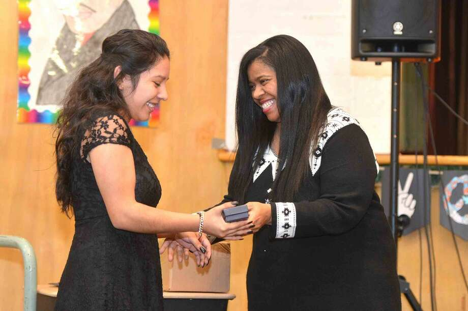 Hour Photo/Alex von Kleydorff Shirley Mosby presents a Student Service Award to Briggs High School's Evelyn Buceta during West Rocks School Rev. Dr. Martin Luther King Jr. Celebration, Renewing The Dream: Hope in Today's Times