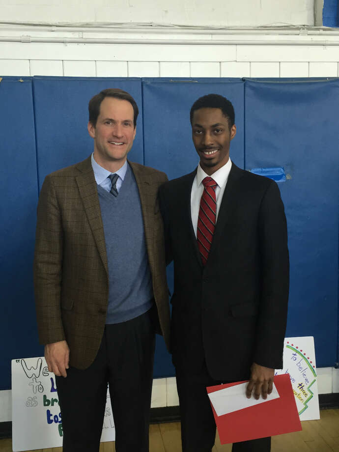 Congressman Jim Himes and Person-to-Person Martin Luther King Jr. Scholarship winner Michael Jean-Paul.