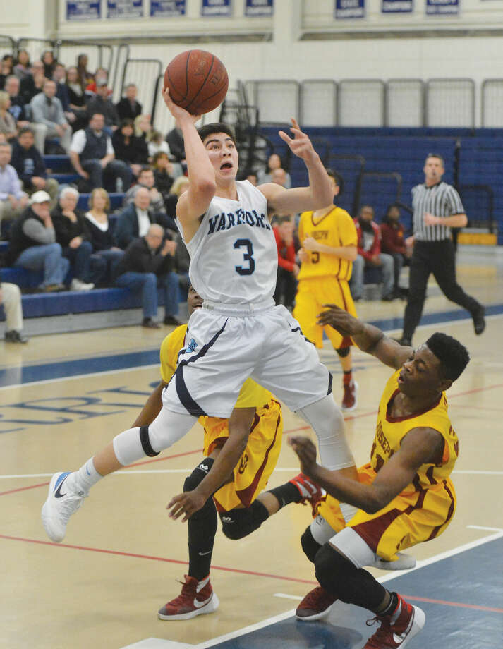 Wilton's No. 3 Matthew Kronenberg shoots and scores vs St Joe's.