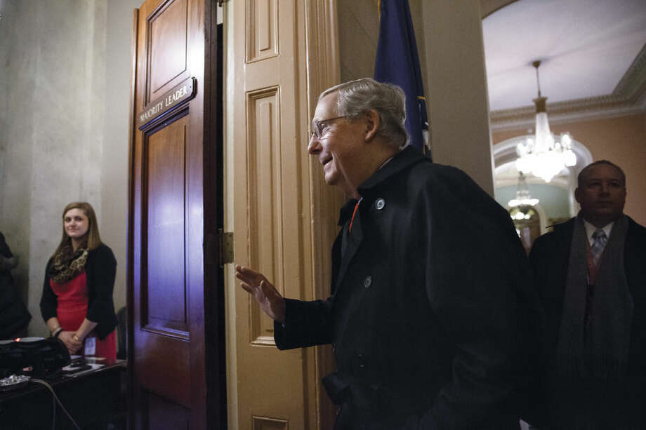 Senate Majority Leader Mitch McConnell of Ky. arrives for work on Capitol Hill in Washington, Monday, Jan. 12, 2015, as the Republican-controlled Senate is moving ahead on a bill to construct the Keystone XL pipeline despite President Barack Obama's veto threat. The House approved the bill last Friday. (AP Photo/J. Scott Applewhite)