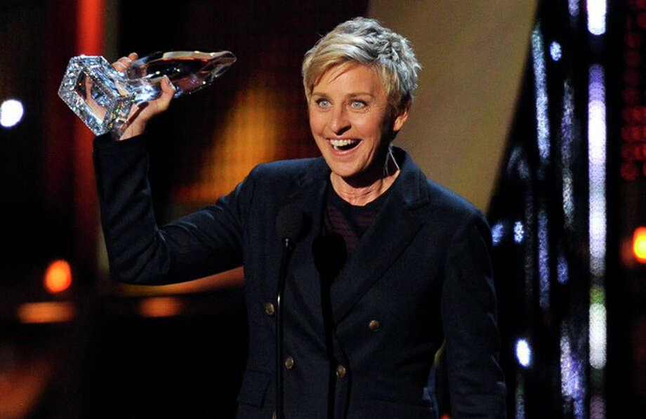 Ellen DeGeneres accepts the award for favorite daytime TV host at the 40th annual People's Choice Awards at the Nokia Theatre L.A. Live on Wednesday, Jan. 8, 2014, in Los Angeles. (Photo by Chris Pizzello/Invision/AP) / Invision