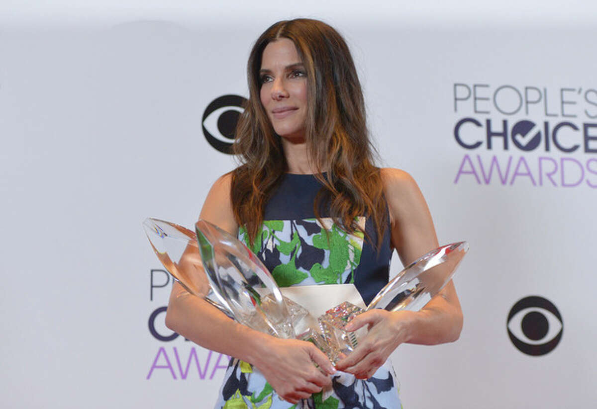 Photo by John Shearer/Invision/AP Sandra Bullock, winner of the Favorite Movie Actress, Favorite Dramatic Movie Actress and Favorite Comedic Movie Actress poses in the press room at the 40th annual People's Choice Awards at Nokia Theatre L.A. Live on Wednesday, Jan. 8, 2014, in Los Angeles.
