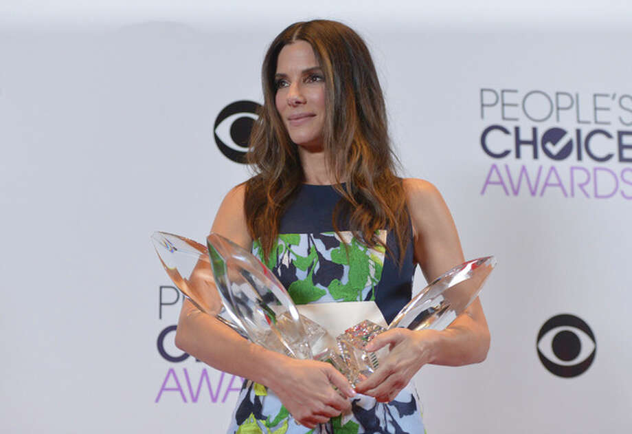 Photo by John Shearer/Invision/APSandra Bullock, winner of the Favorite Movie Actress, Favorite Dramatic Movie Actress and Favorite Comedic Movie Actress poses in the press room at the 40th annual People's Choice Awards at Nokia Theatre L.A. Live on Wednesday, Jan. 8, 2014, in Los Angeles. / Invision