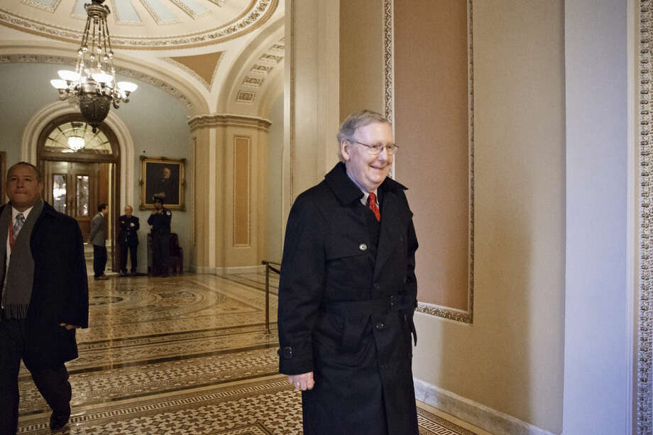 Senate Majority Leader Mitch McConnell of Ky. arrives for work on Capitol Hill in Washington, Monday, Jan. 12, 2015, as the Republican-controlled Senate is moving ahead on a bill to construct the Keystone XL pipeline despite President Barack Obama's veto threat, in Washington. The House approved the bill last Friday. (AP Photo/J. Scott Applewhite)