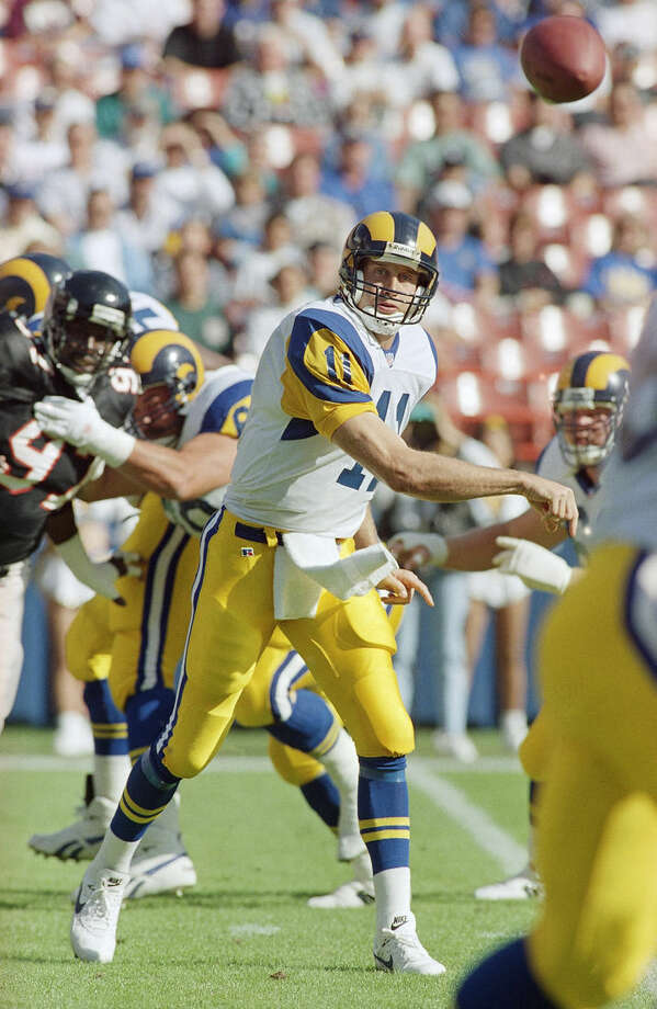 FILE - In this Nov. 14, 1993, file photo, Los Angeles Rams quarterback Jim Everett passes against the Atlanta Falcons during an NFL football game in Anaheim, Calif. Former Rams quarterback Jim Everett says the Rams must be careful to stay focused on football amid the distractions of Hollywood. (AP Photo/File)