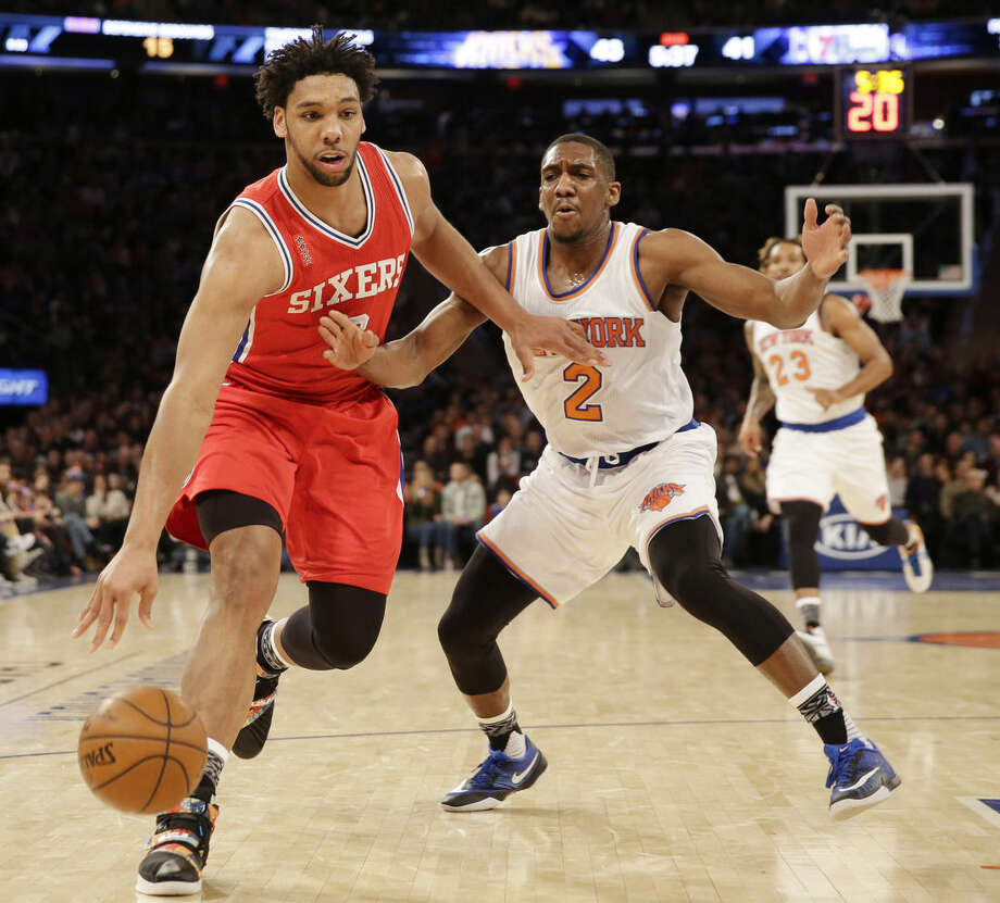 Philadelphia 76ers' Jahlil Okafor, left, pushes past New York Knicks' Langston Galloway during the first half of the NBA basketball game, Monday, Jan. 18, 2016 in New York. (AP Photo/Seth Wenig)