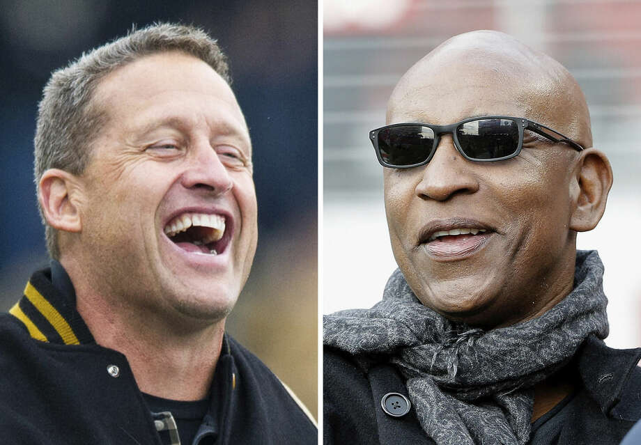 FILE - At left, in a Nov. 22, 2014, file photo, Purdue alumni and retired NFL quarterback Jim Everett walks off the field after being recognized during a break in the first half of an NCAA college football game, in West Lafayette, Ind. At right, in a Jan. 3, 2016,. file photo, former running back Eric Dickerson watches as players warm up before an NFL football game between the San Francisco 49ers and the St. Louis Rams, in Santa Clara, Calif. Eric Dickerson is thrilled his Rams have returned to Los Angeles after 21 years away, but the Hall of Fame running back says the current players in the horned helmets must be ready for both the challenges and the opportunities presented by playing in the nation's glitzy entertainment capital. Former Rams quarterback Jim Everett says the Rams must be careful to stay focused on football amid the distractions of Hollywood(AP Photo/Marcio Jose Sanchez, File)