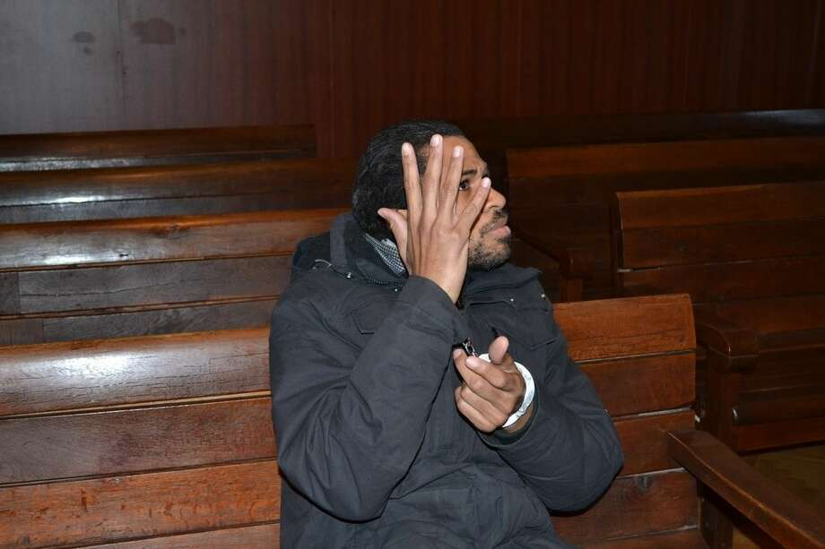 French citizen Fritz-Joly Joachin, 29, sits inside the courtroom before his trial in the town of Haskovo, Bulgaria on Monday, Jan. 12, 2015. Bulgarian authorities said Tuesday Jan. 13 they have arrested a French citizen believed to have links to one of the Kouachi brothers. Fritz-Joly Joachin, 29, was arrested under two European arrest warrants, one citing his alleged links to a terrorist organization, and a second for allegedly kidnapping his 3-year-old son and smuggling him out of the country. (AP Photo/Milen Valchev/Haskovska Marits Newspaper)