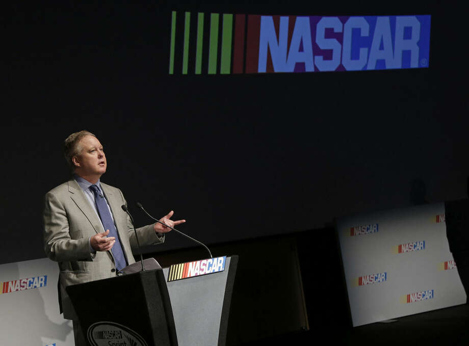 NASCAR Chairman and CEO Brian France speaks to the media during the Charlotte Motor Speedway Media Tour in Charlotte, N.C., Tuesday, Jan. 19, 2016. France announced Tuesday that the Xfinity Series and the Camping World Truck Series will begin using a Chase format in 2016, mostly mirroring the playoff-style setup used to determine the Sprint Cup champion the last two years. (AP Photo/Chuck Burton)
