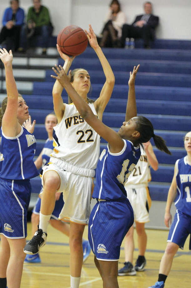 Hour Photo/Alex von Kleydorff.Weston's #22 Bridget Mahony vs Newtown