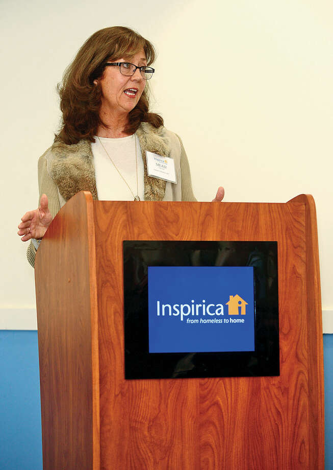 Hour photo / Erik Trautmann St. Josephs Parenting Center Executive Director, Measi O'Rourke, speaks during an opening reception for Inspirica's new Early Childhood and Parenting Program.