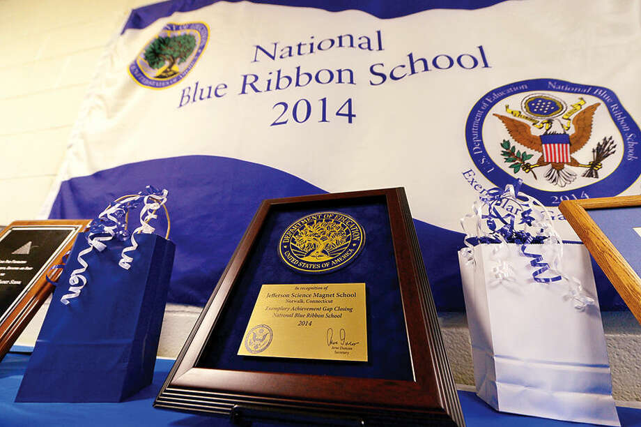 Hour photo / Erik Trautmann Jefferson Science Magnet School celebrates the National Blue Ribbon Award they received for closing the achievement gap between student sub groups during a ceremony Tuesday morning.