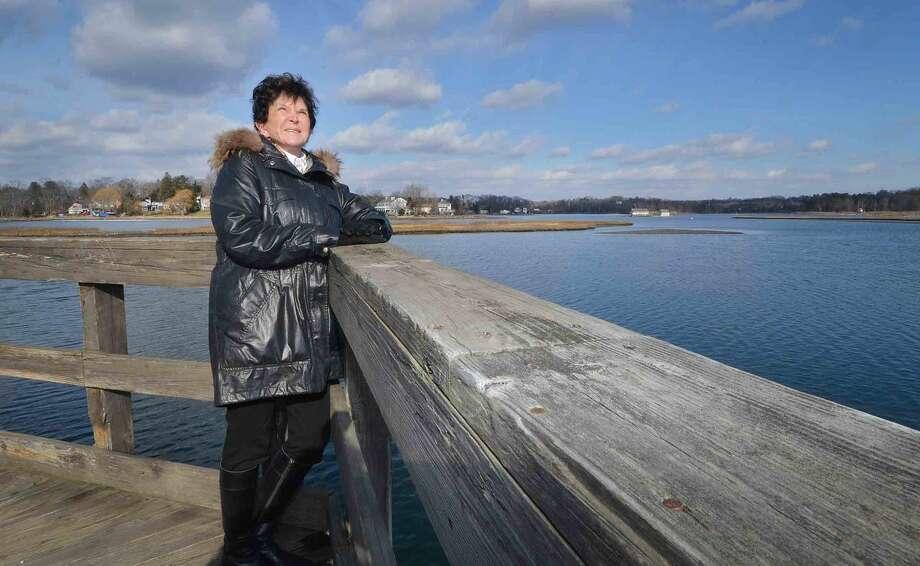 Hour Photo/Alex von Kleydorff Author Judy Katz along one of the bridges on Jennings Trail at Old Mill Pond,