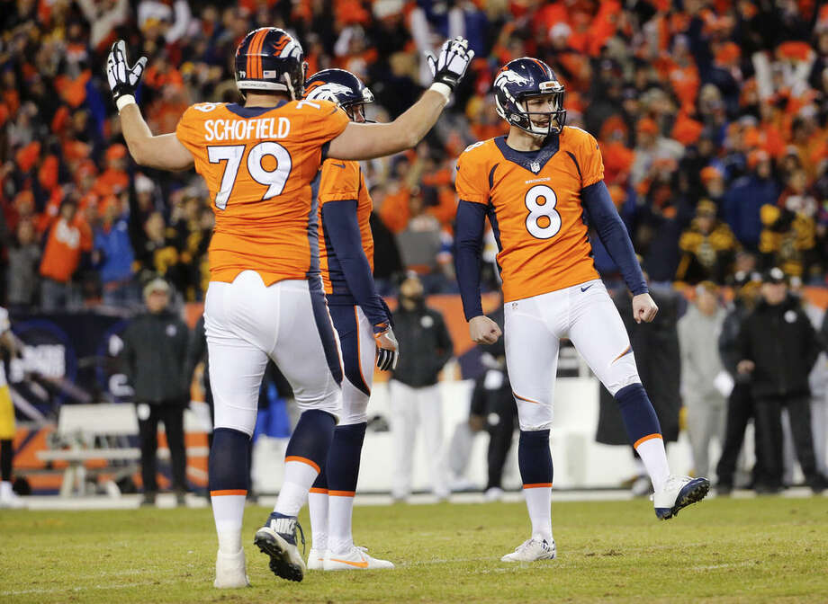 Denver Broncos kicker Brandon McManus, right, celebrates after kicking a field goal with tackle Michael Schofield, left, and Britton Colquitt, center, during the second half in an NFL football divisional playoff game, Sunday, Jan. 17, 2016, in Denver. (AP Photo/Jack Dempsey)