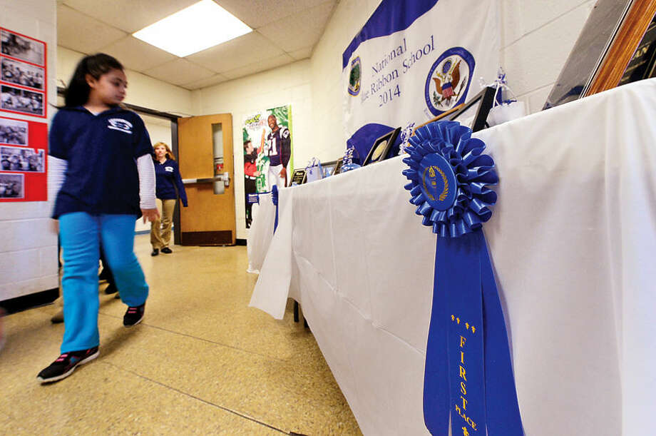 Hour photo / Erik Trautmann Jefferson Science Magnet School celebrates the National Blue Ribbon Award they received for closing the achievement gap between student sub-groups during a ceremony Tuesday morning.