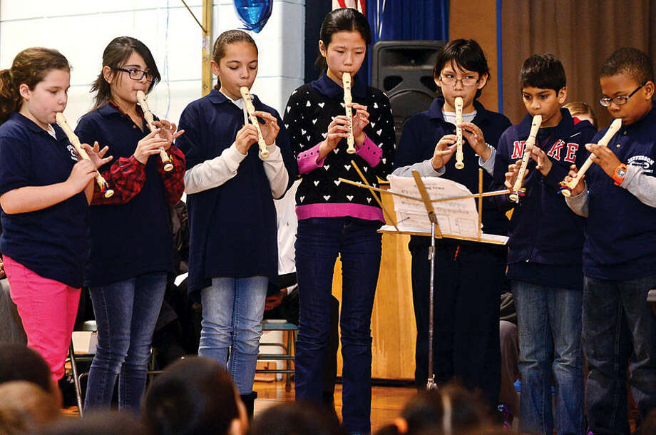 Hour photo / Erik Trautmann The Jefferson Science Magnet School Black Belt Recorder Players play Ode to Joy as the school celebrates the National Blue Ribbon Award they received for closing the achievement gap between student sub-groups during a ceremony Tuesday morning.