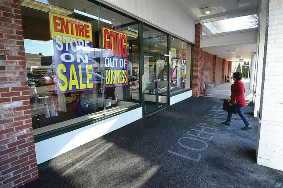 Hour Photo/Alex von KleydorffA shopper walks into Loehmann's on West Avenue in Norwalk on Thursday. Loehmann's will close all 40 of its stores and is holding liquidation sales now.