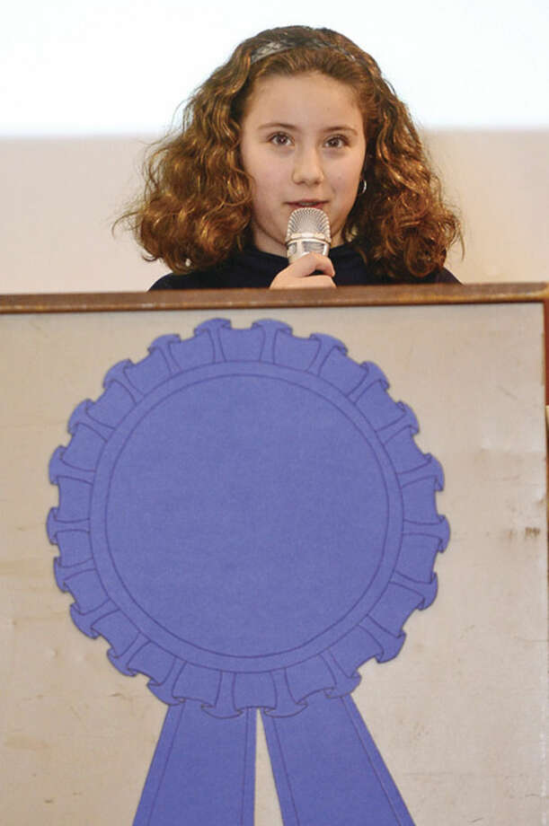 Hour photo / Erik Trautmann Jefferson Science Magnet School 5th grader Kaitlyn Giancaspro sepaks to students, faculty and guests as the school celebrates the National Blue Ribbon Award they received for closing the achievement gap between student sub-groups during a ceremony Tuesday morning.