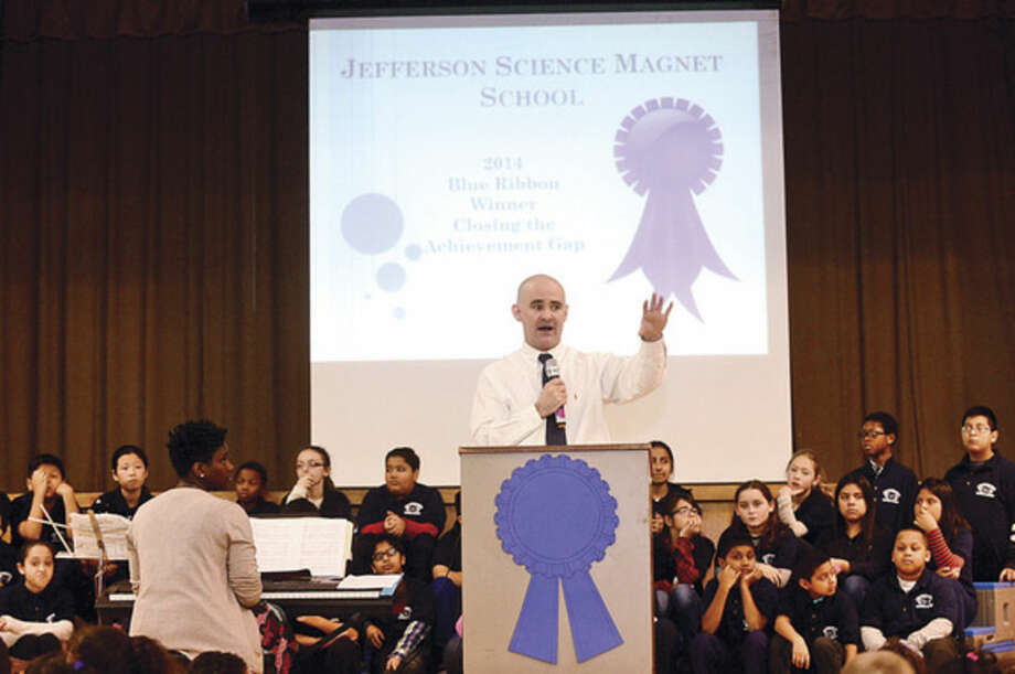 Hour photo / Erik Trautmann Jefferson Science Magnet School principal John Reynolds speaks to the students, faculty and guests as the school celebrates the National Blue Ribbon Award they received for closing the achievement gap between student sub-groups during a ceremony Tuesday morning.