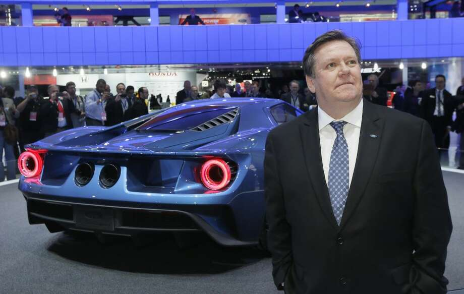 Ford Motor Co., Vice President of Design Moray Callum stands next to the automaker's new GT on the floor of the North American International Auto Show, Monday, Jan. 12, 2015 in Detroit. (AP Photo/Carlos Osorio)