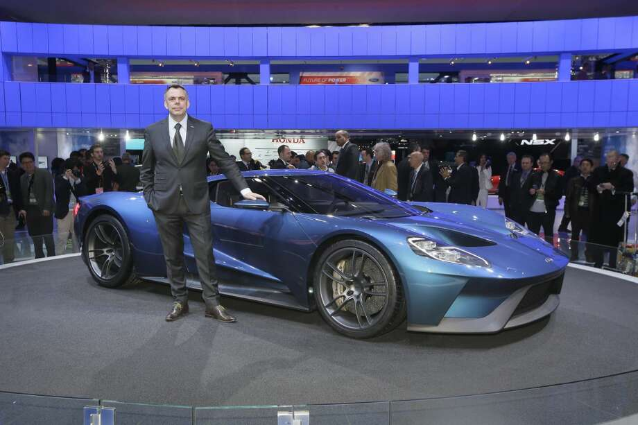 Ford Motor Co., Design Director, The Americas, Christopher Svensson stands next to the Ford GT during the North American International Auto Show, Monday, Jan. 12, 2015 in Detroit. (AP Photo/Carlos Osorio)