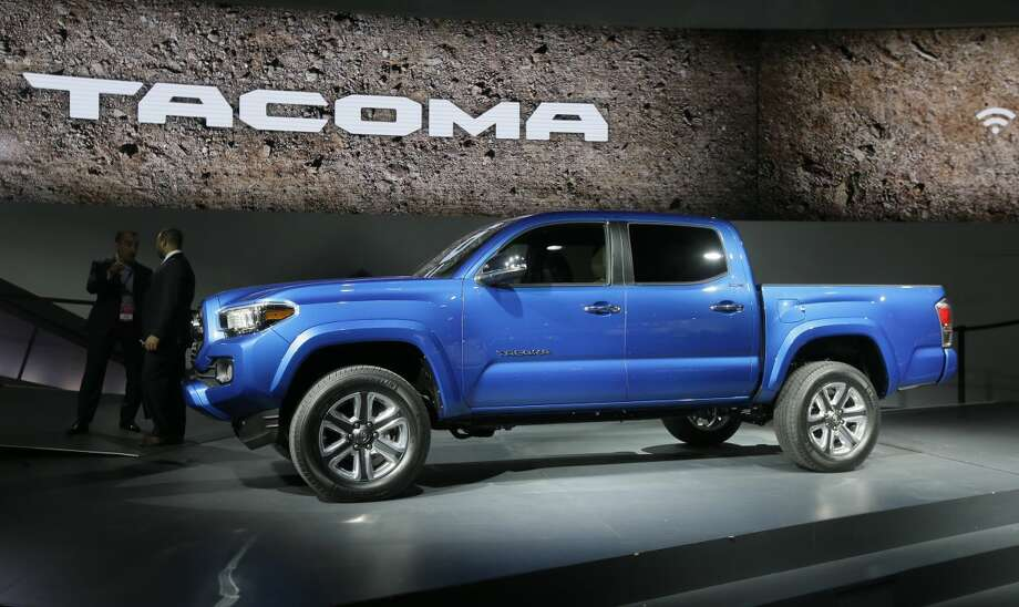 The new Toyota Tacoma truck is unveiled during the North American International Auto Show, Monday, Jan. 12, 2015 in Detroit. (AP Photo/Carlos Osorio)
