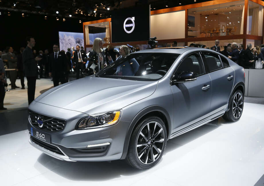A Volvo S60 Cross Country is on display during media previews for the North American International Auto Show in Detroit Monday, Jan. 12, 2015. (AP Photo/Paul Sancya)